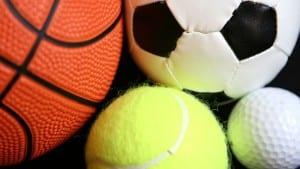 A basketball a football a tennisball and a golfball