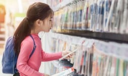 Back to school concept Little asian girl or pupil buying school supplies in store