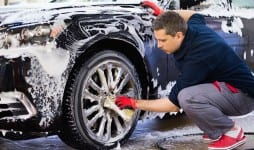 Man washing cars alloy wheels