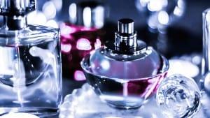 Perfume bottle and vintage fragrance on vanity table
