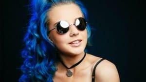 Smiling blue hair girl in glasses