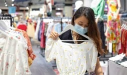 asian woman shopping clothing store face