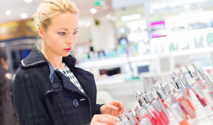 blond lady testing and buying cosmetics in a beauty store
