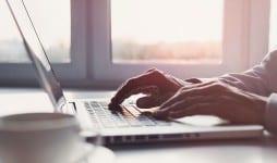 business man using laptop computer home