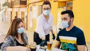 clients masks on terrace bar spain