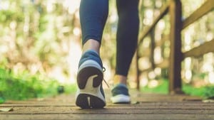 close female legs running shoes on