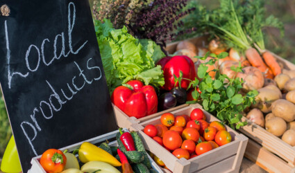 counter fresh vegetables sign local products