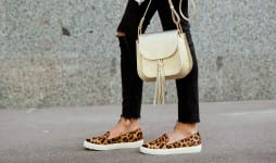 fashionable young woman black jeans white