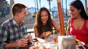 friends having fun outdoor restaurant eating