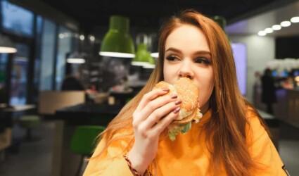 girl eats a burger