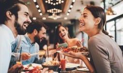 group happy friends having breakfast restaurant