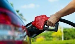hand refilling car fuel
