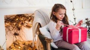 happy child girl sitting on armchair