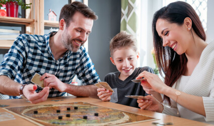 happy family playing board game