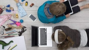 kids behind tablet computer