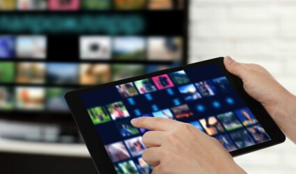 streaming video services woman using tablet