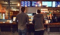 two men choose food fast restaurant