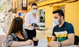 waitress bar spain serves food drinks