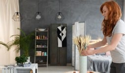 woman decorating contemporary apartment