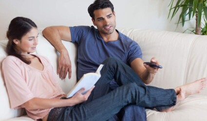 woman reading book while her fiance
