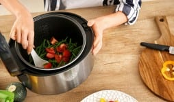 woman using modern multi cooker kitchen