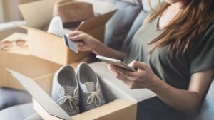 young woman received online shopping